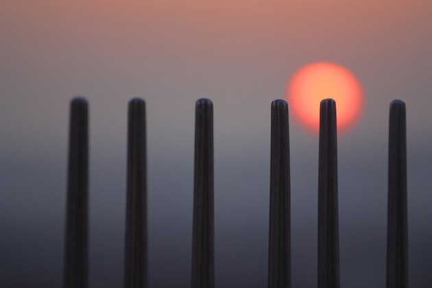 Sunset behind posts