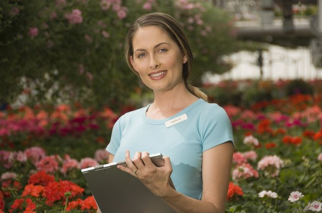 Woman taking inventory of flowers