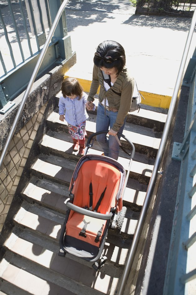 Mother and daughter with stroller on steps