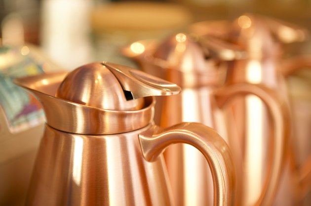 Row of copper coffeepots