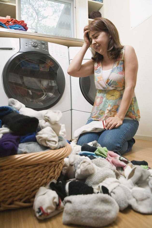 Stressed woman in laundry room