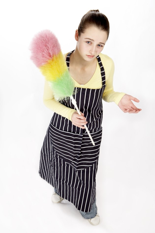 Teenage girl with dusting wand