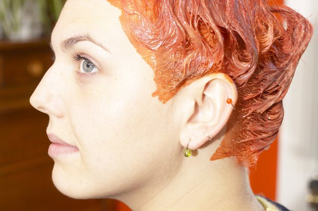 Profile of woman with red hair dye