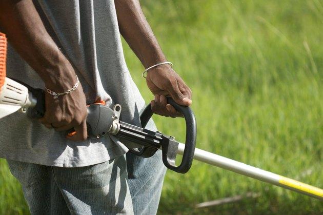 Gardener Mowing Lawn In The Caribbean