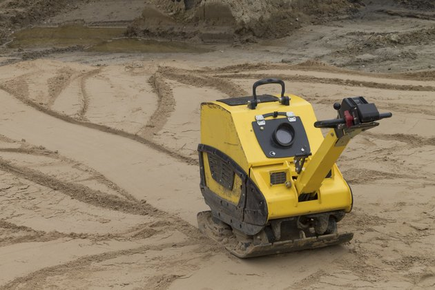 Compaction of sand before the construction  road