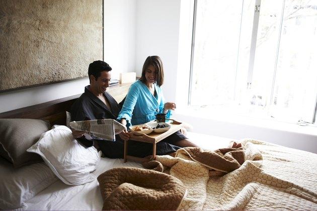 Hispanic couple in luxury bedroom