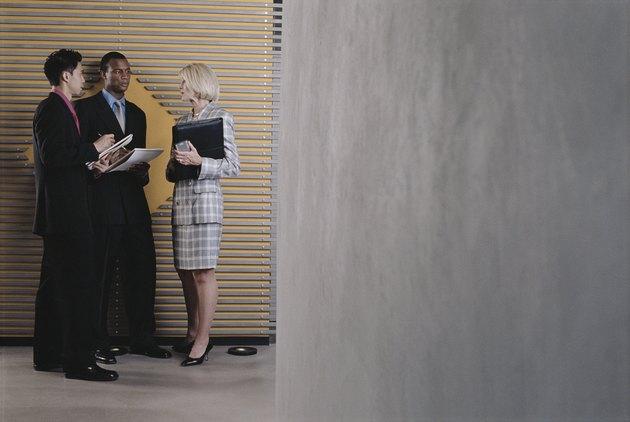 Businesspeople standing in hallway