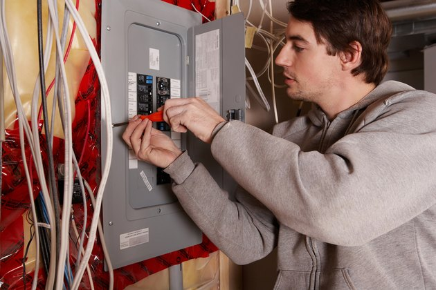 Man with electrical panel
