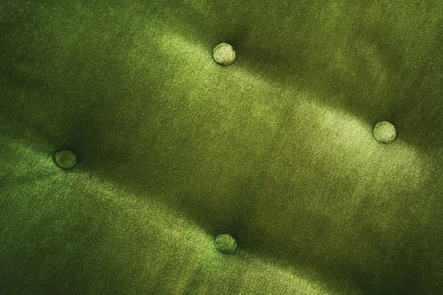 Detail of green velvet chair