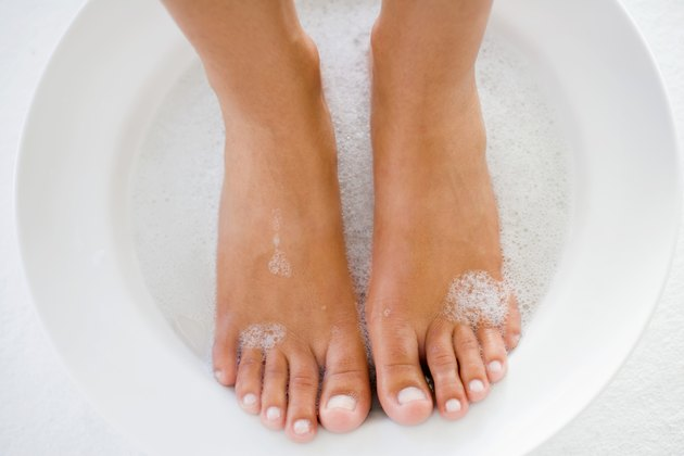 Feet soaking in soapy water
