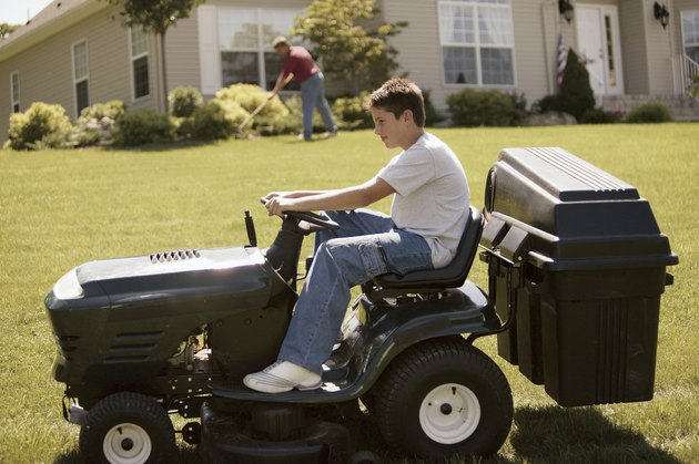 Boy on tractor mower