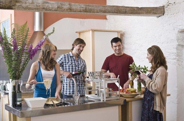 Friends together in kitchen
