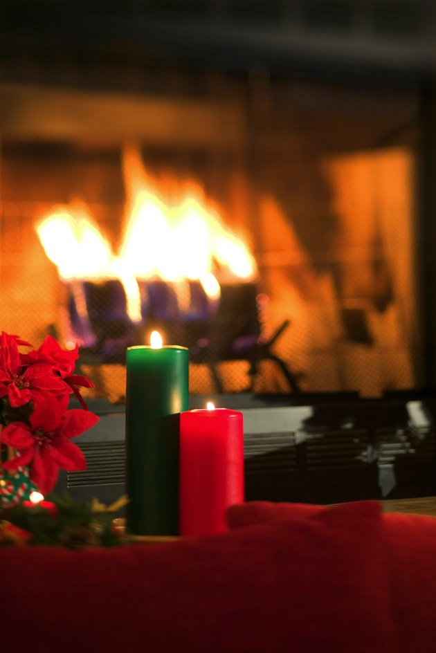 Candles by fireplace