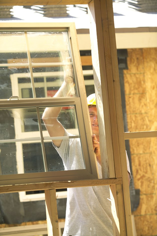Construction worker installing a new window