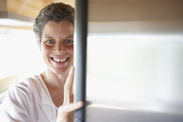 Mixed Race woman looking in refrigerator