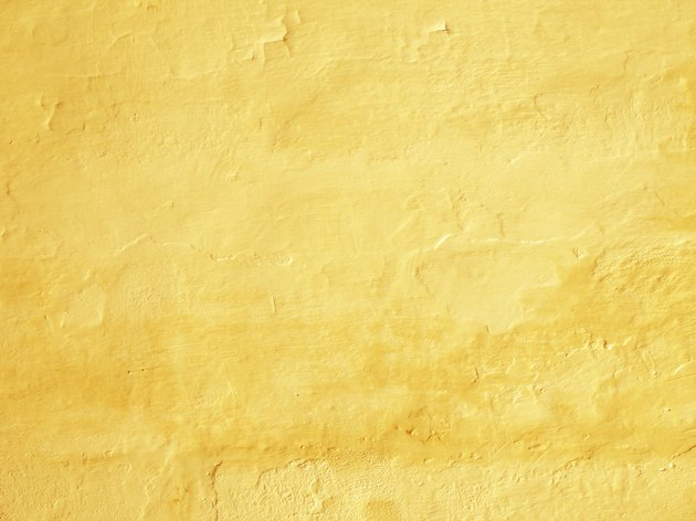 Vibrant yellow painted tuscany wall