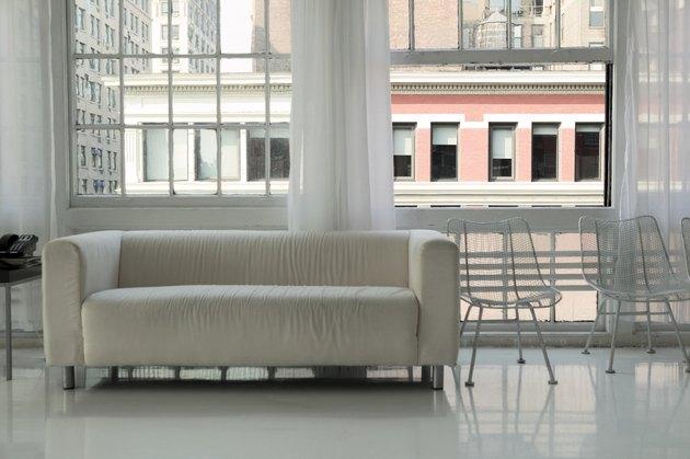 View of cream sofa in city apartment