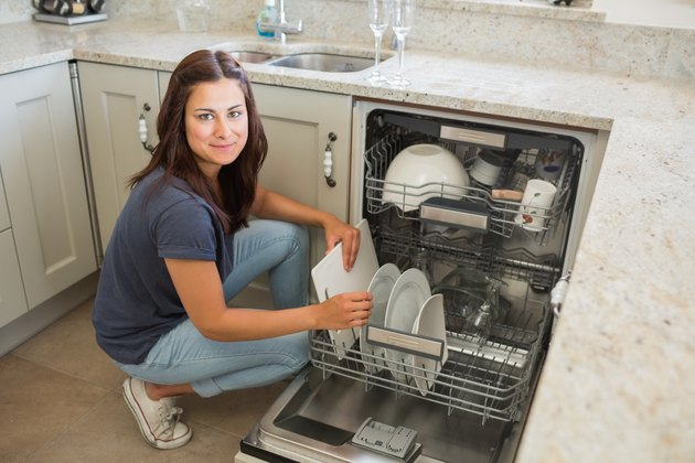 Woman loading the dishwasher