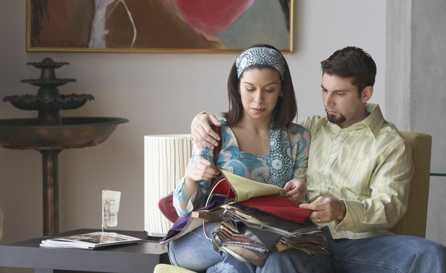 Young couple looking at fabric swatches