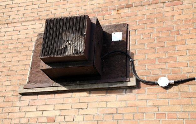 Fan mounted in sealed window of building
