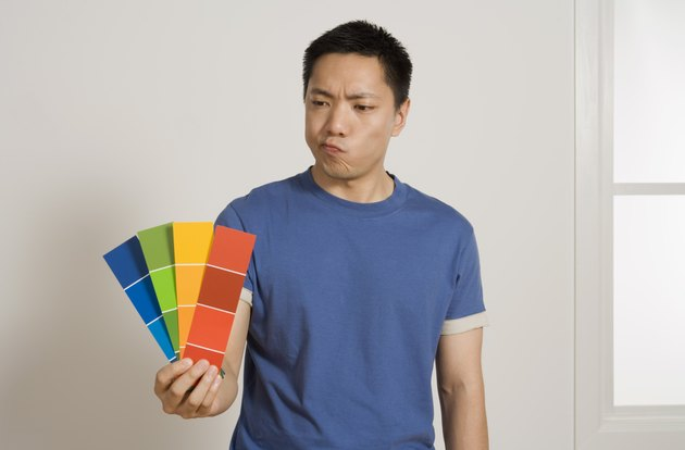 Man holding paint samples
