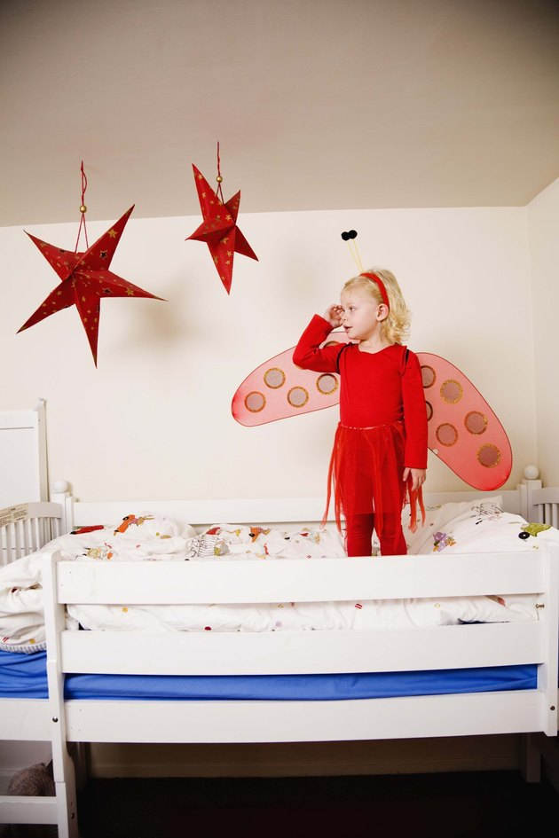 Girl in fairy costume on bunk bed