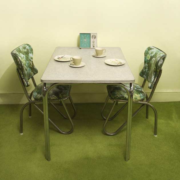 Retro 50' || chr(39) || 's formica and chrome dinette set with green vinyl chairs.