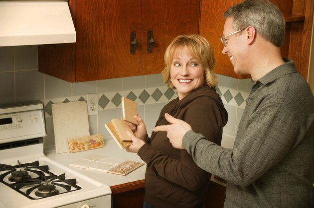 Couple choosing tile for kitchen