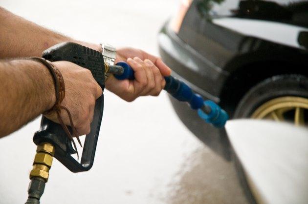 Hands with a car wash sprayer