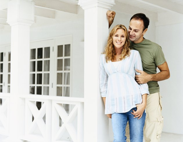 Portrait of a Couple Standing Together on Their Porch