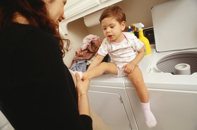 Mother and child (21-24 months) in laundry room