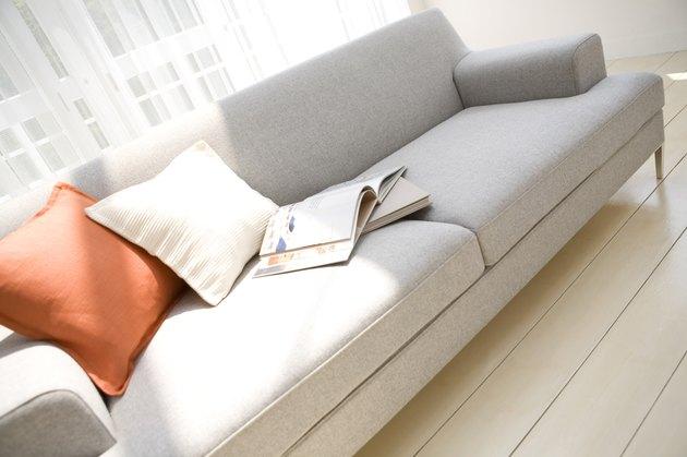 Books on sofa in living room