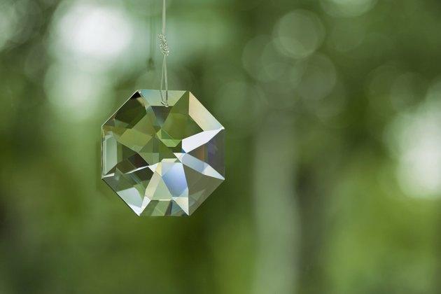 Crystal prism on defocused green background