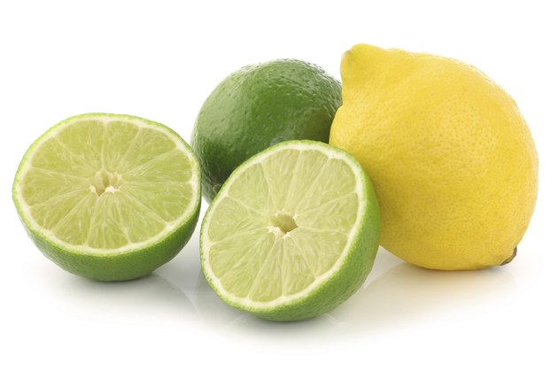 colorful fresh lime ,lemon fruit and a cut one