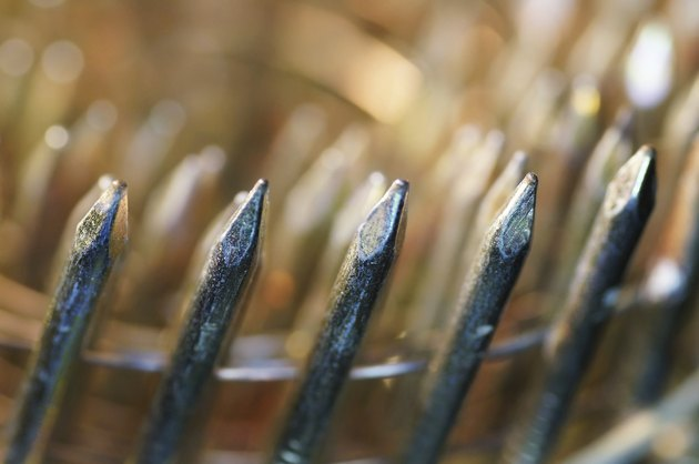 Macro of upright view used stack nails gun