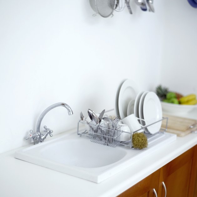 a kitchen wash basin with a plate rack