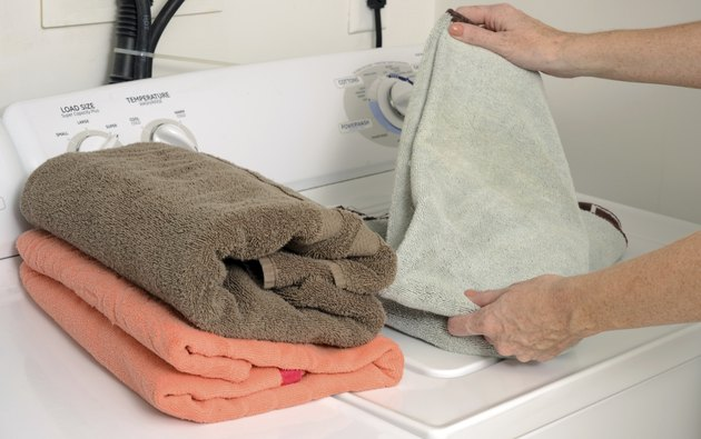 folding clean towels and laundry