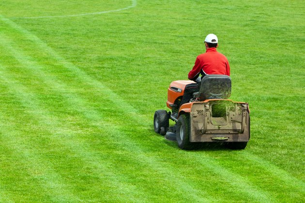Mowing grass in stadium