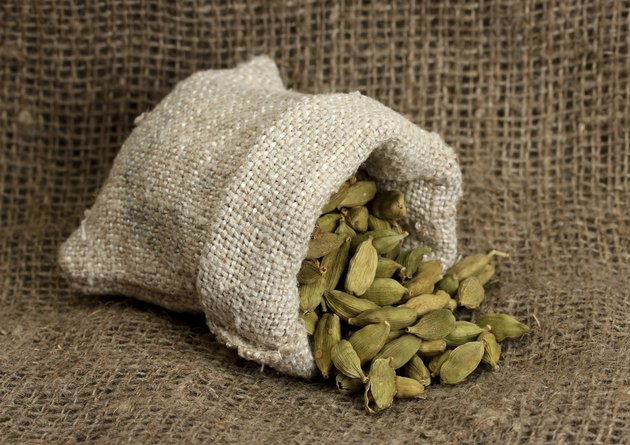 Green cardamom in sack on canvas background