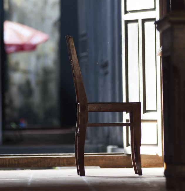 silhouette Old fashioned chair on wooden floor