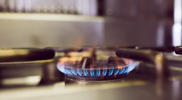 Burning gas on kitchen gas stove