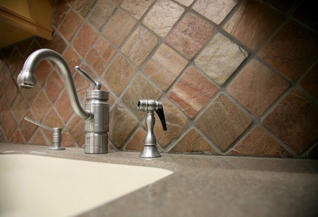 Faucet and sink in contemporary home kitchen