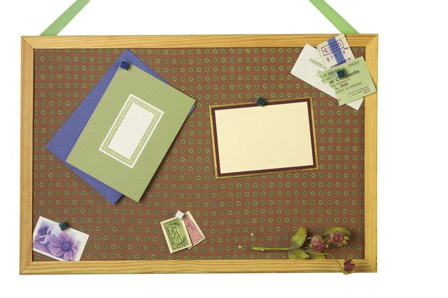 Greeting cards and memorabilia on bulletin board