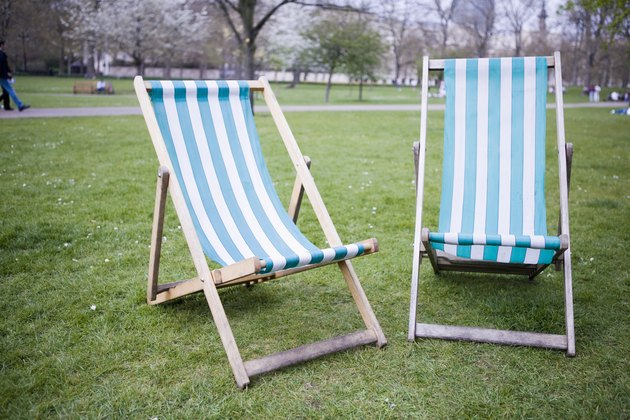 Traditional wood-framed deck chairs with vinyl seat in urban park