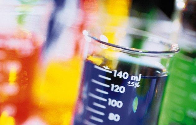 Laboratory beakers full of liquid
