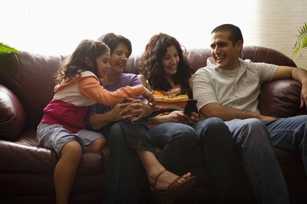 family laughing at cell phone