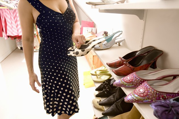 Woman deciding which shoes to wear