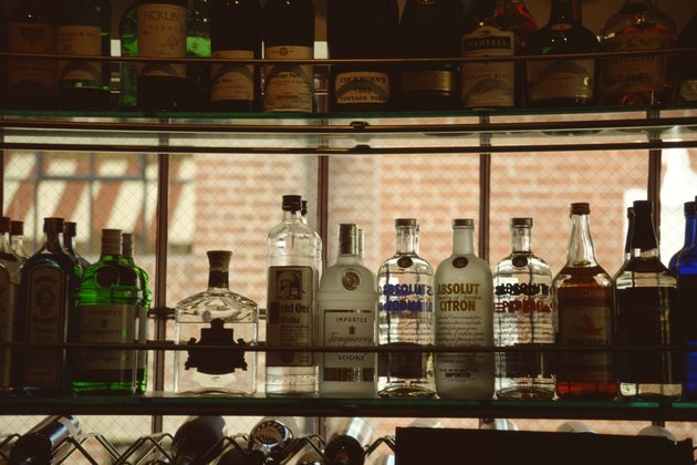 Liquor bottles in bar window
