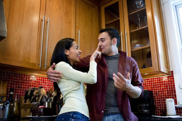 Couple being playful in kitchen