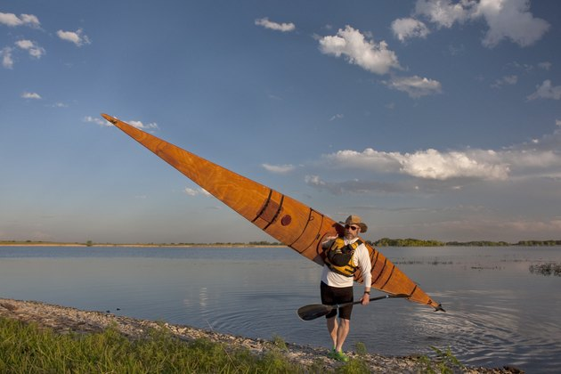 paddler with wooden sea kayak